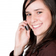 Beautiful girl smiling on the phone — Stock Photo