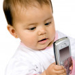 Baby girl with a mobile phone — Stock Photo