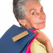 Beautiful elderly woman with shopping bags — Stock Photo