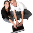 Stock Photo: Casual couple on laptop