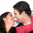 Beautiul couple smiling at each other - Stock Photo