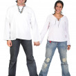 Casual couple in white holding hands — Stock Photo