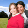 Beautiful couple in the park - Stock Photo