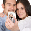 Casual couple taking a pic with their mobile — Stock Photo