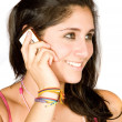 Beautiful girl talking on the phone — Stock Photo