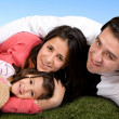 Beautiful family in the park — Stockfoto