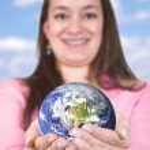Girl holding globe — Stock Photo