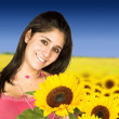 Beautiful girl in sunflower field - Stock Photo