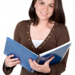 Beautiful student hugging a notebook — Stock Photo
