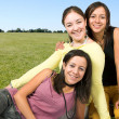 Beautiful happy girls outdoors — Stock Photo