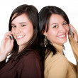 Beautiful girls on cell phones — Stock Photo