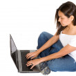 Beautiful girl using a laptop — Stock Photo