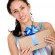 Casual girl with a gift — Stock Photo