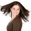 Beautiful girl with moving hair - Stock Photo