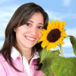 Casual girl with a flower — Stock Photo