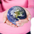 Hands holding globe -  
