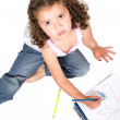 Stock Photo: Girl colouring a drawing