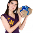 Stock Photo: Girl wondering what she got for gift
