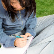 Beautiful student working outdoors — Stock Photo