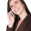 Beautiful teenager smiling on the phone - Stock Photo