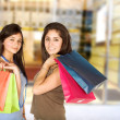 Beautiful teenagers with shopping bags — Stock Photo
