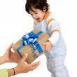 Child receiving a gift — Stock Photo