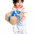 Happy boy with a gift — Stock Photo