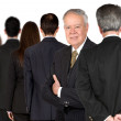 Royalty-Free Stock Photo: Business senior and his team
