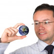 Business man holding globe — Stock Photo