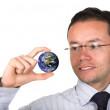 Business man holding globe — Stock Photo