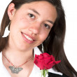 Beautiful girl holding a red rose — Stock Photo #7706479