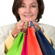 Business woman with shopping bags — Стоковое фото