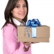 Girl offering gift — Stock Photo #7706542