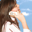 Casual girl on the phone outdoors — Stock Photo