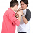 Casual guys fighting - Stockfoto