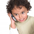 Cute kid talking on the phone — Stock Photo