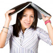 Female student with book on head — Stock Photo