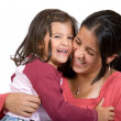 Foto Stock: Girl with her mum having a laugh