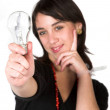 Casual girl with lightbulb — Stock Photo