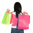 Girl in pink holding shopping bags - Stock Photo