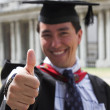 Happy graduate - thumbs up - Foto Stock