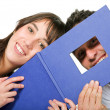 Couple of students with photobook - Stock Photo