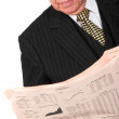 Business manager reading newspaper — Stock Photo