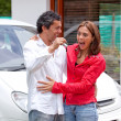 Couple with their car — Stock Photo