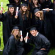 Stock Photo: Happy graduation students