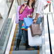 Loving couple on escalators - Stock Photo
