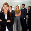 Business woman and her team — Stock Photo #7707205