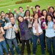 Large group with thumbs up - Foto Stock
