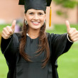 Thumbs up graduation woman — Stock Photo #7707229