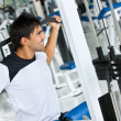 Man at the gym - weights - Stock Photo